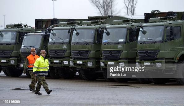 Members of the Bundeswehr Germany's armed forces prepare to load a Patriot antimissile system onto a ship for transport to Turkey on January 8 2013...
