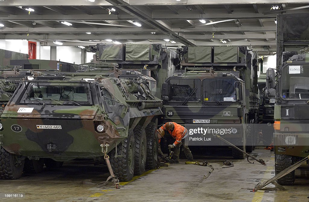 A members of the Bundeswehr, Germany's armed forces, secures a Patriot anti-missile system on a ship for transport to Turkey on January 8, 2013 in Travemunde, Germany. Germany is deploying two Patriot batteries and 400 troops as part of a NATO operation that also involves Dutch and U.S. Patriot units to defend Turkey from possible Syrian attack.