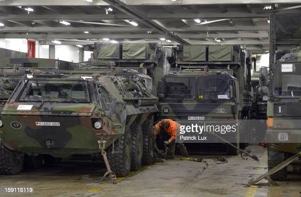 A members of the Bundeswehr Germany's armed forces secures a Patriot antimissile system on a ship for transport to Turkey on January 8 2013 in...