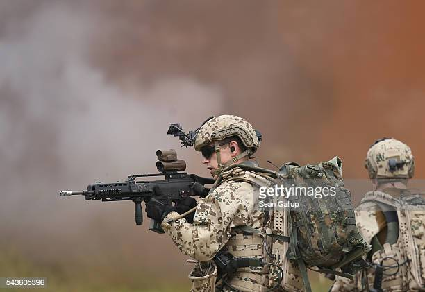Members of the Bundeswehr the German armed forces participate in a demonstration of capabilities of Panzergranadierbataillon 33 of the 1st Panzer...