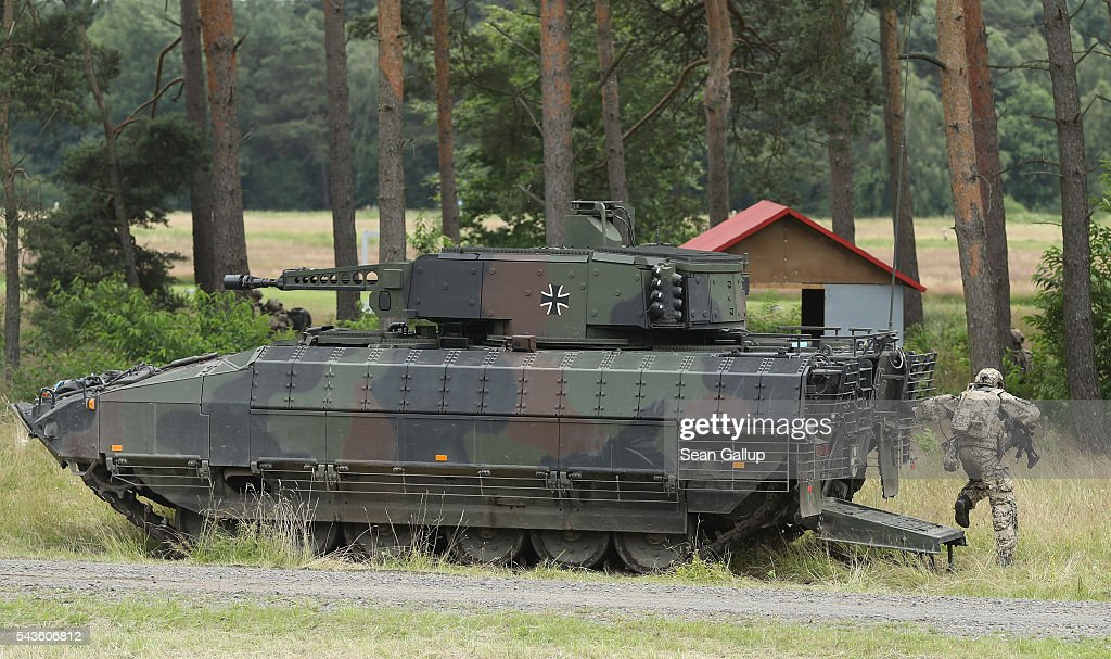 Members of the Bundeswehr, the German armed forces,jump out of a Puma infantry fighting vehicle during a demonstration of capablities of Panzergranadierbataillon 33 of the 1st Panzer Division (1. Panzerdivision) on June 29, 2016 near Neustadt am Ruebenberge, Germany. The Bundeswehr is aquirung the Puma in phases and the vehicle replaces the Marder.