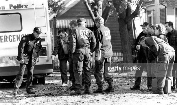 Members of the Bureau of Alcohol Tobacco and Firearms and the Boston Police Department bomb squad search for clues on the scene where a bomb was...