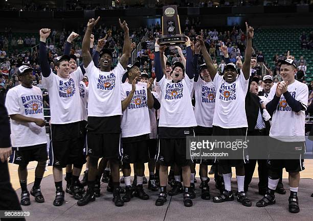 Members of the Butler Bulldogs celebrate after defeating the Kansas State Wildcats during the west regional final of the 2010 NCAA men's basketball...