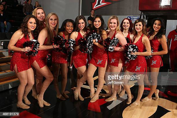 Members of the Cal State Northridge Matadors Dance Team smile as they pose for a photo before the game against the UC Santa Barbara Gauchos at The...