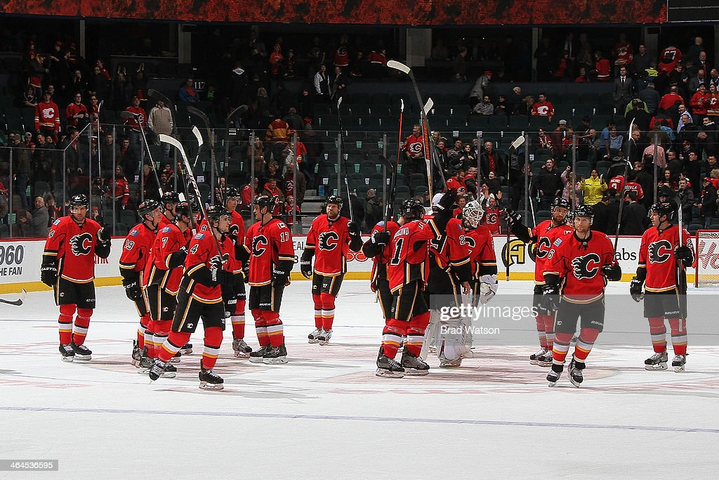 Members of the Calgary Flames acknowledge the crowd after a 3-2 win against the Phoenix Coyotes at Scotiabank Saddledome on January 22, 2014 in Calgary, Alberta, Canada.