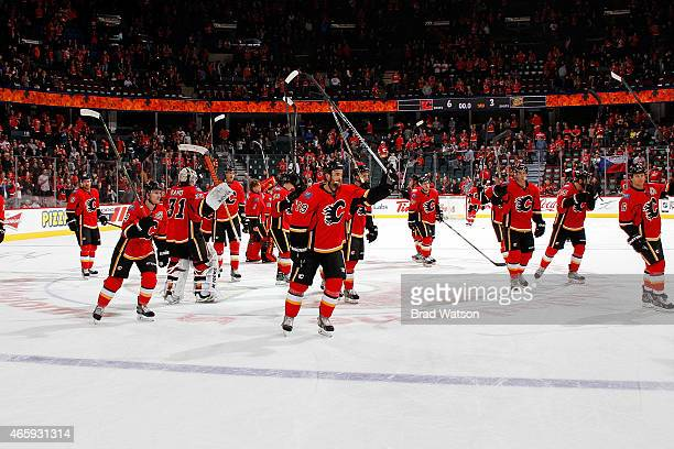 Members of the Calgary Flames acknowledge the crowd after a 63 win against the Anaheim Ducks at Scotiabank Saddledome on March 11 2015 in Calgary...