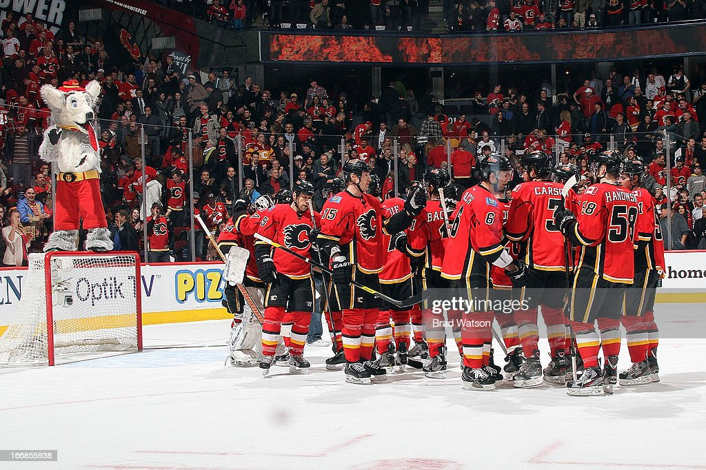 Members of the Calgary Flames celebrate a win over the Detroit Red Wings on April 17, 2013 at the Scotiabank Saddledome in Calgary, Alberta, Canada.