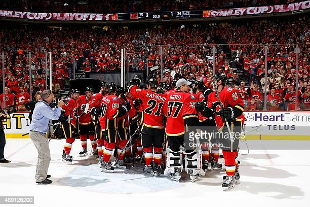 Members of the Calgary Flames celebrate after a 31 win against the Los Angeles Kings at Scotiabank Saddledome on April 9 2015 in Calgary Alberta...