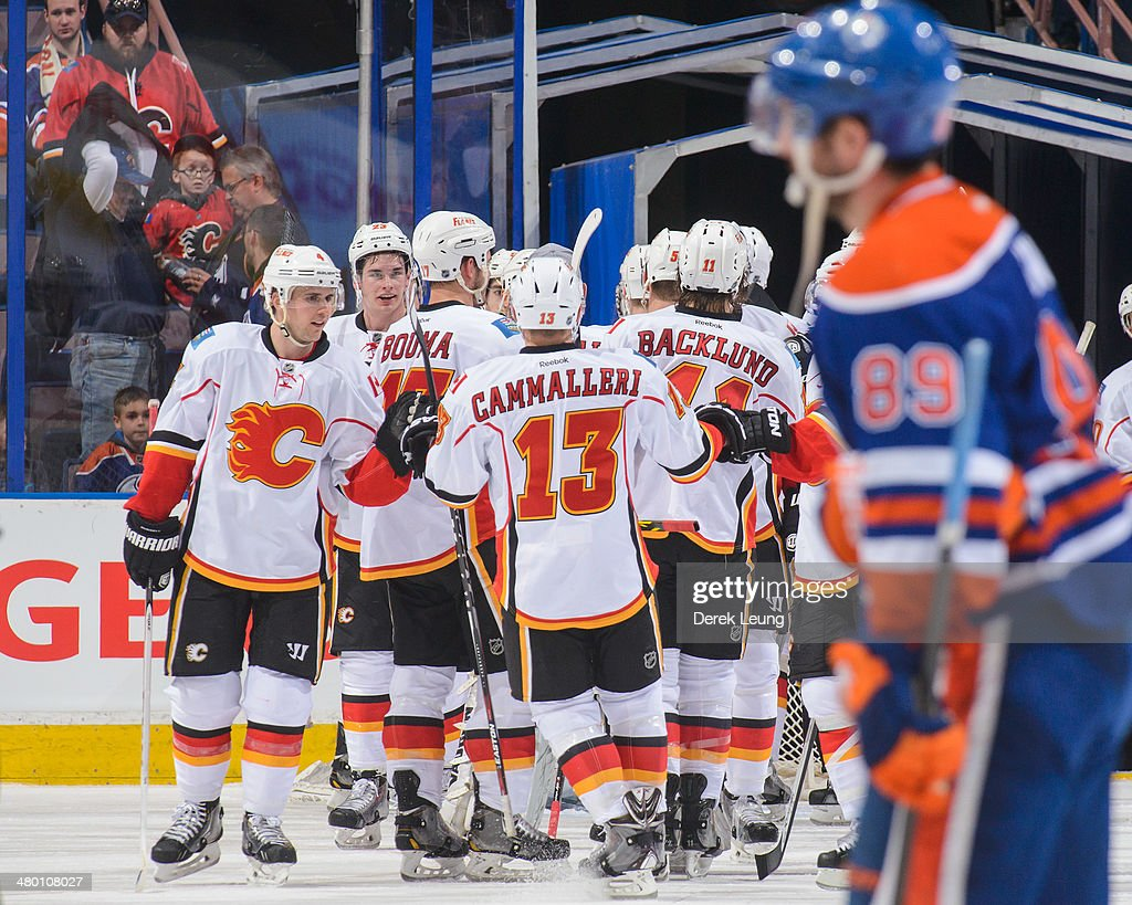 Members of the Calgary Flames celebrate after defeating the Edmonton Oilers during an NHL game at Rexall Place on March 22, 2014 in Edmonton, Alberta, Canada. The Flames defeated the Oilers 8-1.
