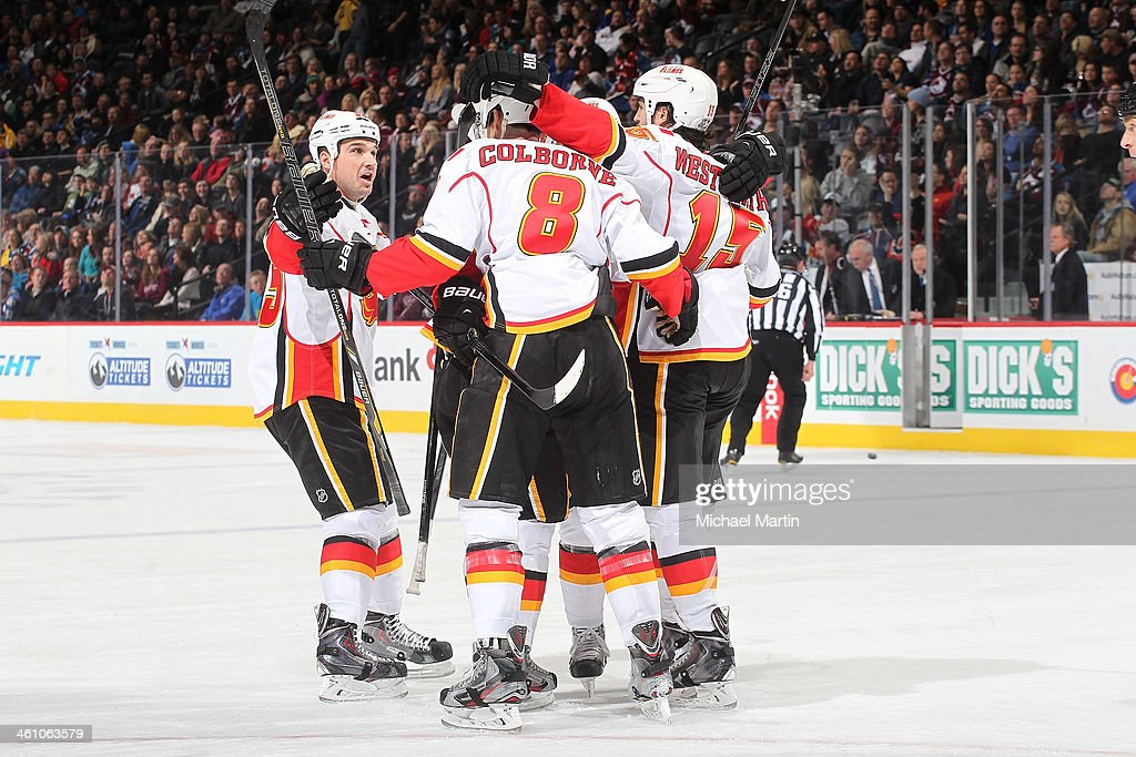 Members of the Calgary Flames celebrate after scoring against the Colorado Avalanche at the Pepsi Center on January 06, 2014 in Denver, Colorado.