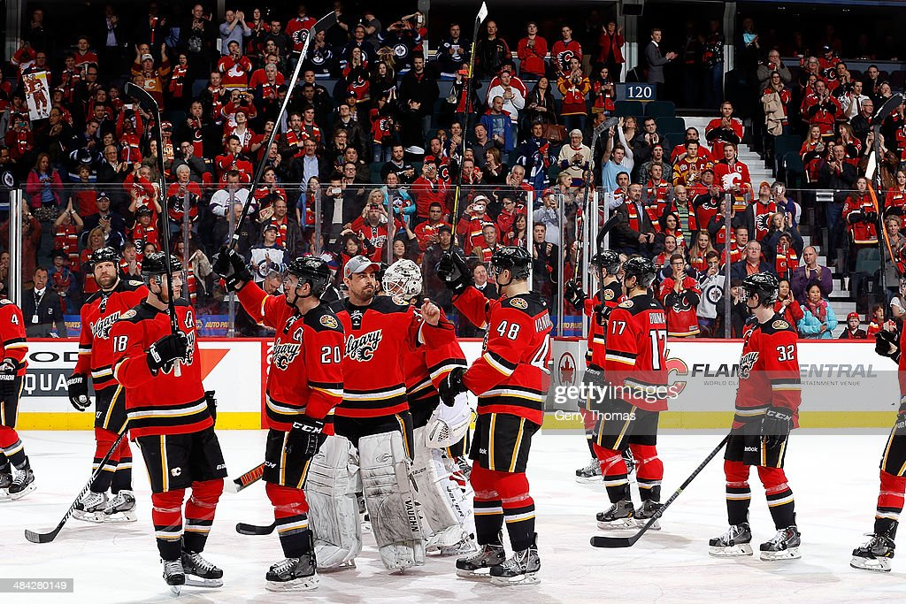 Members of the Calgary Flames salute the crowd after their final home game of the season against the Winnipeg Jets at Scotiabank Saddledome on April 11, 2014 in Calgary, Alberta, Canada.