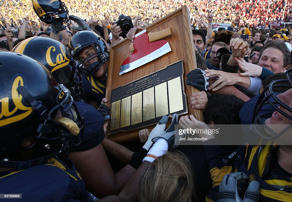 Members of the California Golden Bears run with 'The Axe' after defeating the Stanford Cardinal during an NCAA football game on November 22 2008 at...