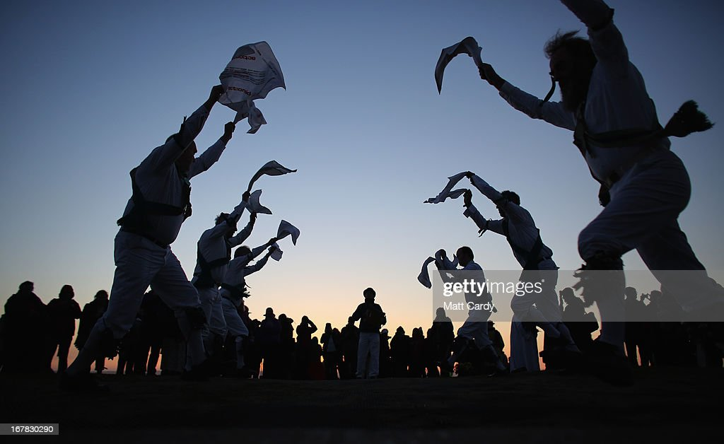 Members of the Cam Valley Morris Men dance at a May Day dawn celebration in front of St. Michael's Tower on Glastonbury Tor on May 1, 2013 in Glastonbury, England. Although more synonymous with International Workers' Day, or Labour Day, May Day or Beltane is celebrated by druids and pagans as the beginning of summer and the chance to celebrate the coming of the season of warmth and light. Other traditional English May Day rites and celebrations include Morris dancing and the crowning of a May Queen with celebrations involving a Maypole.