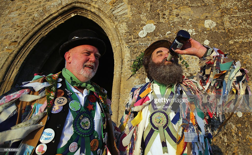 Members of the Cam Valley Morris Men share a beer after they complete their dance at a May Day dawn celebration in front of St. Michael's Tower on Glastonbury Tor on May 1, 2013 in Glastonbury, England. Although more synonymous with International Workers' Day, or Labour Day, May Day or Beltane is celebrated by druids and pagans as the beginning of summer and the chance to celebrate the coming of the season of warmth and light. Other traditional English May Day rites and celebrations include Morris dancing and the crowning of a May Queen with celebrations involving a Maypole.