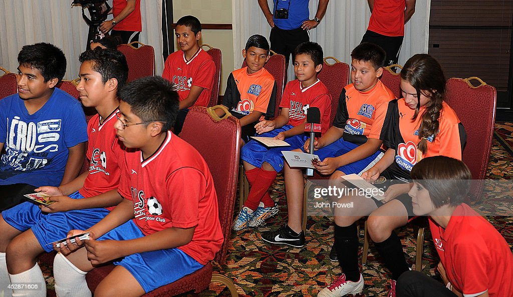 Members of the Camden Youth Soccer Club attend a Q and A session with Conor Cody of Liverpool, Lucas of Liverpool and <a gi-track='captionPersonalityLinkClicked' href=/galleries/search?phrase=Mamadou+Sakho&family=editorial&specificpeople=4154099 ng-click='$event.stopPropagation()'>Mamadou Sakho</a> of Liverpool at the Liverpool Team Hotel in Princeton on July 28, 2014 in Princeton, New Jersey.