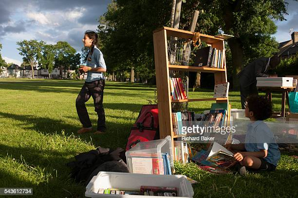 Members of the campaign to save nearby Carnegie Library in Herne Hill and closed by Lambeth council organise a popup library and party in Ruskin Park...