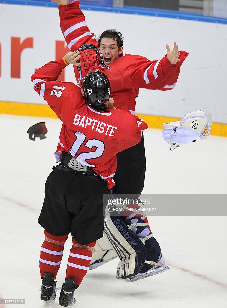 Members of the Canadian team celebrate their 3-2 victiory over team USA during the IIHF U18 International Ice Hockey World Championships final game in Sochi on April 28, 2013.