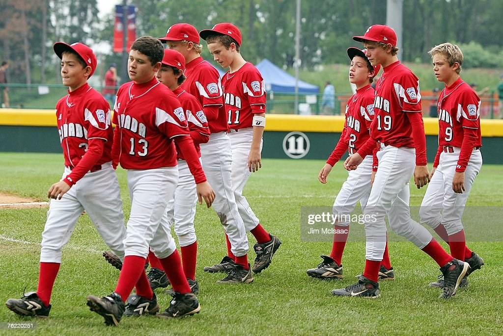 Members of the Canadian team from White Rock British Columbia walk on the field after losing to the Caribbean team from Willemstad Curacao during...