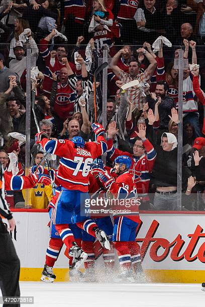 Members of the Canadiens celebrate a goal by Max Pacioretty in Game One of the Eastern Conference Semifinals against the Tampa Bay Lightning during...