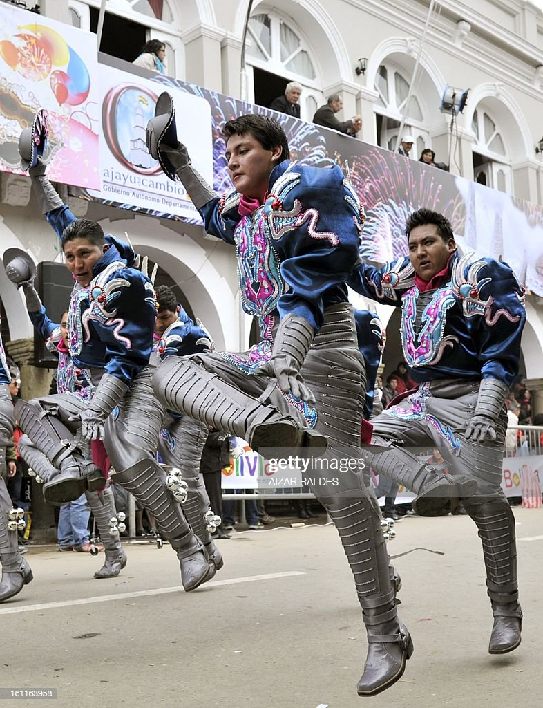 Members of the Caporales San Simon brotherhood take part in Carnival of Oruro, in the mining town of Oruro, 240 km south of La Paz on February 9, 2013. The Carnival of Oruro was inscribed by UNESCO on the Representative List of the Intangible Cultural Heritage of Humanity in 2008.