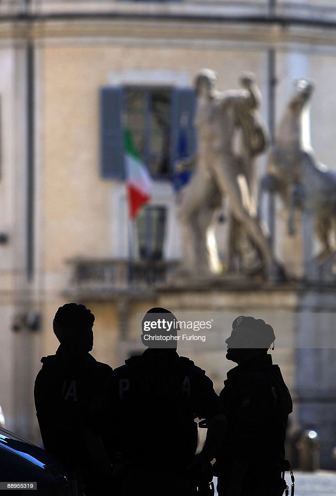 Members of the Carabinere chat at Palazzo Del Quirinale on July 9, 2009 in Rome, Italy. With nearly 3000 years of history Rome continues to live up to its motto of The Eternal City being one of the founding cities of Western Civilisation.