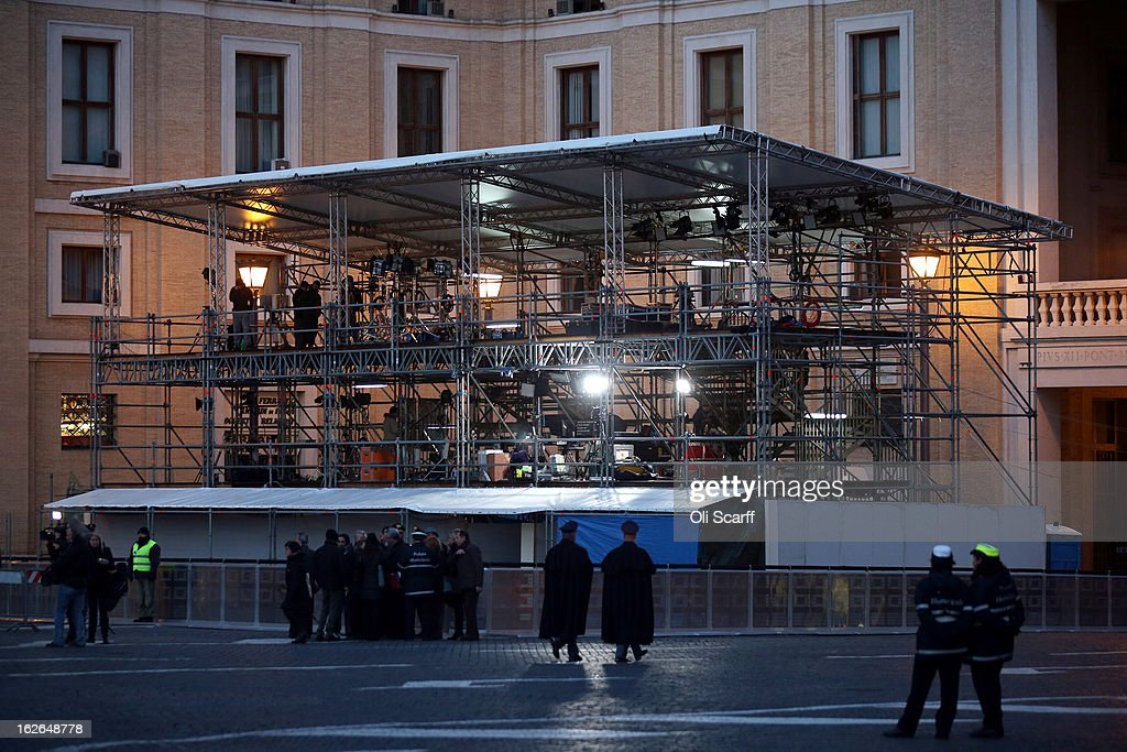 Members of the Carabinieri walk past a scaffolding structure adjacent to St Peter's Square, for the use of television news crews, ahead of Pope Benedict XVI's last public audience on February 25, 2013 in Vatican City, Vatican. The Pontiff will hold his last weekly public audience on February 27, 2013 before he retires the following day. Pope Benedict XVI has been the leader of the Catholic Church for eight years and is the first Pope to retire since 1415. He cites ailing health as his reason for retirement and will spend the rest of his life in solitude away from public engagements.