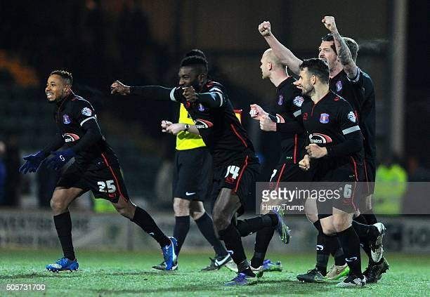 Members of the Carlisle team celebrate as Mark Ellis of Carlisle United scores the winning penalty during the Emirates FA Cup Third Round replay...