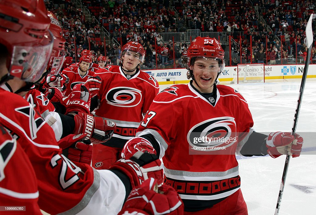 Members of the Carolina Hurricanes, led by Jeff Skinner #53, are congratulated by teammates at the bench following Skinner's second-period goal against the Buffalo Sabres during their NHL game at PNC Arena on January 24, 2013.
