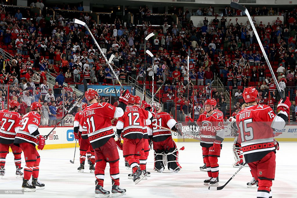 Members of the Carolina Hurricanes salute their fans following the team's 4-3 overtime loss to the New York Rangers during their NHL game at PNC Arena on April 25, 2013 in Raleigh, North Carolina.