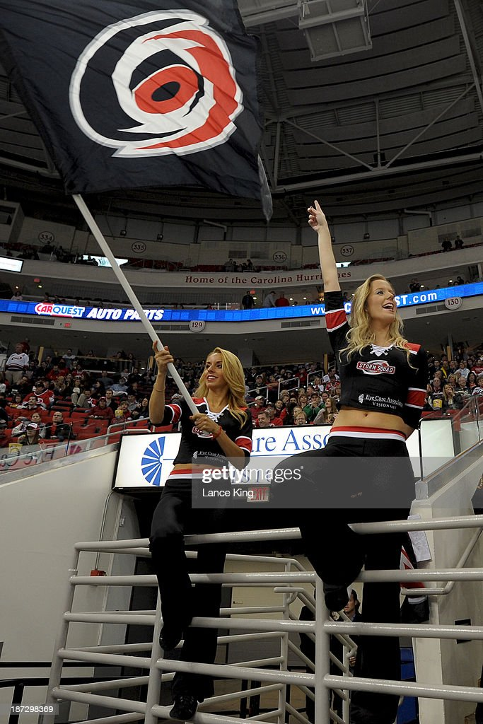 Members of the Carolina Hurricanes Storm Squad cheer during a game against the New York Islanders at PNC Arena on November 7, 2013 in Raleigh, North Carolina.