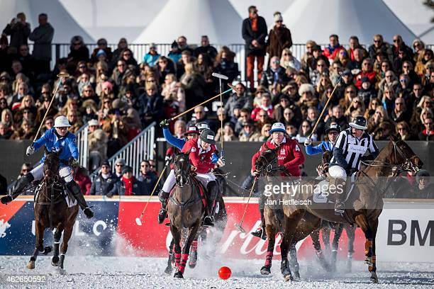 Members of the 'Cartier' team battle for the ball with team 'BMW' during the final of the Snow Polo World Cup 2015 on February 01 2015 in St Moritz...