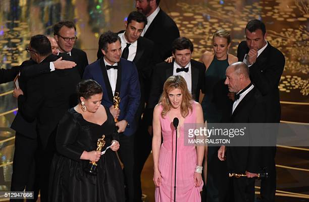 Members of the cast and producers of Spotlight accept the award for Best Picture at the 88th Oscars on February 28 2016 in Hollywood California AFP...