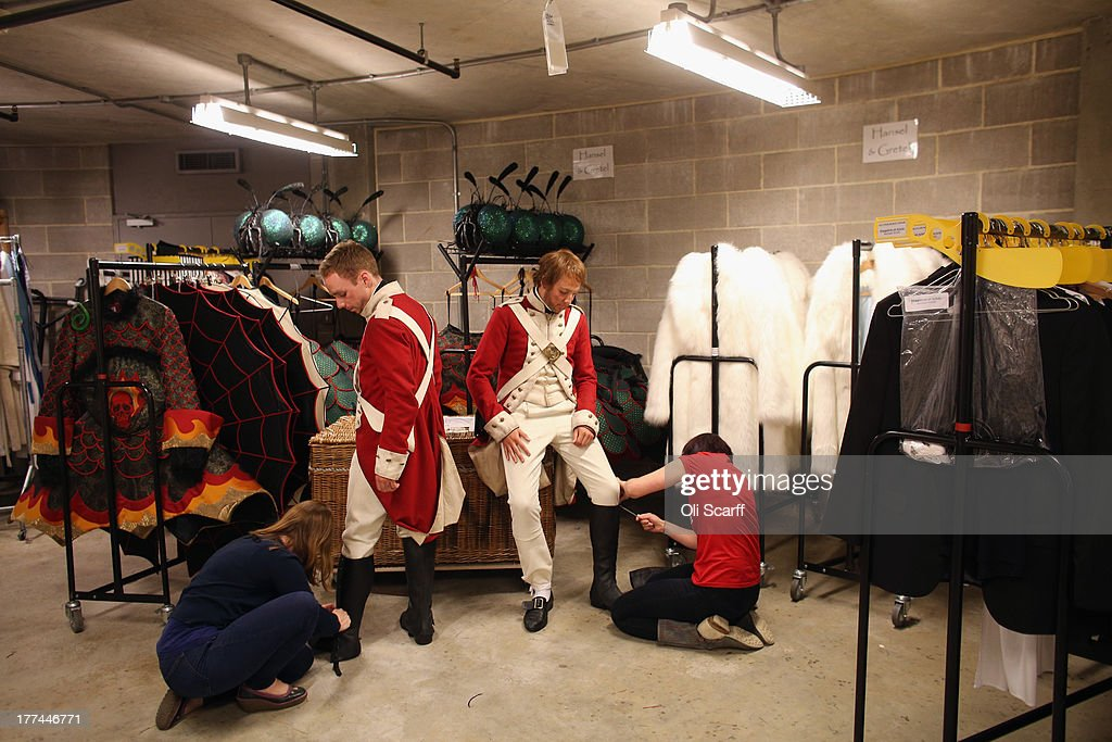 Members of the cast at Glyndebourne opera house have their costumes adjusted by Running Wardrobe staff at the end of the long interval of a production of the Benjamin Britten opera 'Billy Budd' on August 22, 21013 in Lewes, England. The Glyndebourne Festival of six operas performed at the East Sussex opera house from May until August sees its final performance of the season on August 25, 2013. The Glyndebourne opera house stands in the grounds of the country home of John Christie, who founded it in 1934, today it is recognised globally as one of the world's great opera houses.
