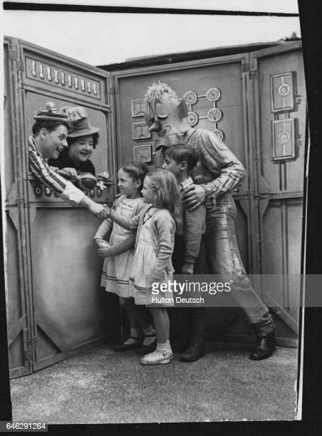 Members of the cast from Jack and the Beanstalk being performed in Kennington Park Trevor Richins Rosie O'Grady and Brian Burdon meet young members...