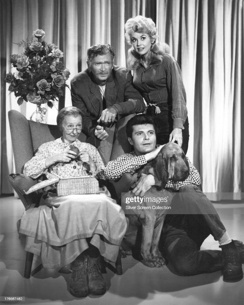 Members of the cast of the TV series 'The Beverly Hillbillies' in a publicity still, circa 1965. Clockwise, from left: Irene Ryan (1902 - 1973), as Granny Daisy Moses, <a gi-track='captionPersonalityLinkClicked' href=/galleries/search?phrase=Buddy+Ebsen&family=editorial&specificpeople=894081 ng-click='$event.stopPropagation()'>Buddy Ebsen</a> (1908 - 2003) as Jed Clampett, <a gi-track='captionPersonalityLinkClicked' href=/galleries/search?phrase=Donna+Douglas&family=editorial&specificpeople=990336 ng-click='$event.stopPropagation()'>Donna Douglas</a> as Elly May Clampett and Max Baer Jr. as Jethro Bodine.