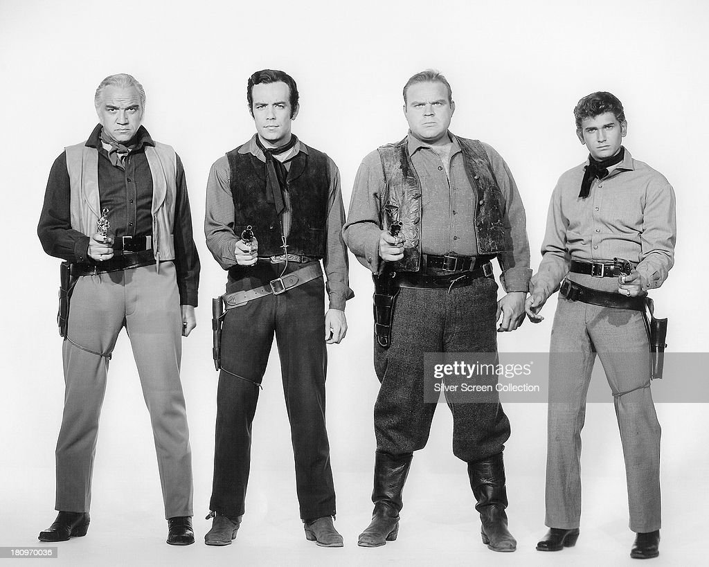 Members of the cast of the TV western series 'Bonanza', circa 1965. Left to right: Lorne Greene (1915 - 1987) as Ben Cartwright, Pernell Roberts (1928 - 2010) as Adam Cartwright, Dan Blocker (1928 - 1972) as Eric 'Hoss' Cartwright, and Michael Landon (1936 - 1991) as Joseph 'Little Joe' Cartwright.