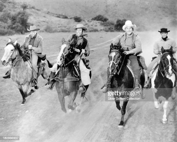 Members of the cast of the TV western series 'Bonanza' on hoseback circa 1965 Left to right Lorne Greene as Ben Cartwright Pernell Roberts as Adam...