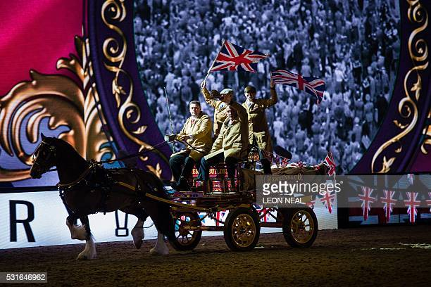 Members of the cast perform in the arena during the final night of The Queen's 90th Birthday Celebrations at the Royal Windsor Horseshow in the...