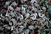 Members of the 'Castellers de Sants' Human Tower team fall after forming a 'castell' during the XXV human towers or castells competetion in Tarragona...