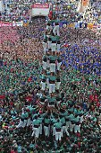 Members of the 'Castellers de Villafranca' Human Tower team form a 'castell' during the XXV human towers or castells competetion in Tarragona on...