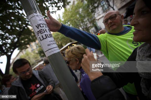 Members of the Catalan National Assembly distribute information through the streets of Barcelona in full day asking for the vote in the referendum of...