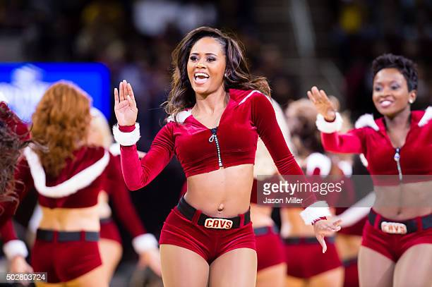 Members of the Cavalier Girls dance team perform during a timeout during the first half of the game between the Cleveland Cavaliers and the...