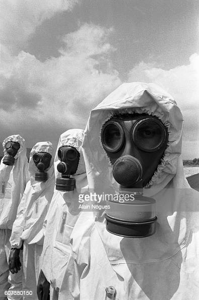 Members of the Cellule Mobile d'Intervention Radiologique unit of French firefighters model their protective Nucleaire Biologique et Chimique suits...