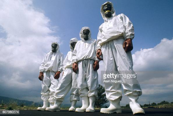 Members of the Cellule Mobile d'Intervention Radiologique unit of French firefighters model their protective chemical suits for treatment of...