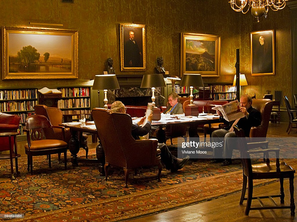 Members of The Century Association reading in the library room The Century Association is a New York City club with a distinguished history...