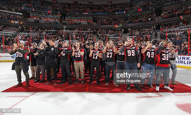 Members of the CFL Grey Cup champions Ottawa Redblacks are introduced before an NHL game between the Ottawa Senators and the Philadelphia Flyers at...
