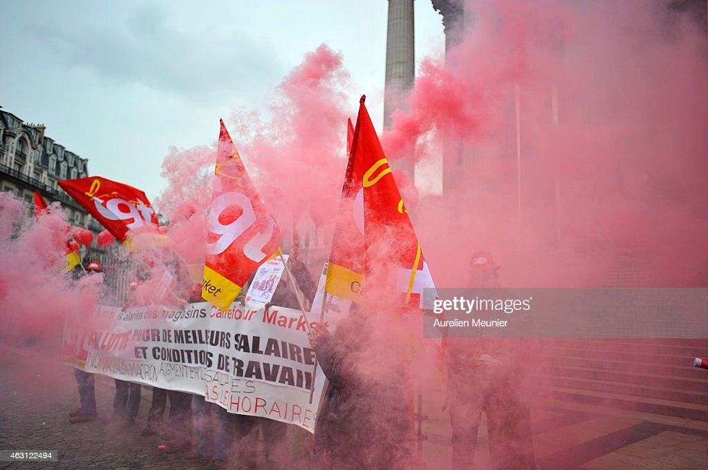 Members of the CGT the French General Confederation of Labour Union take part in a protest against the Macron Law at Place de la Madeleine on...