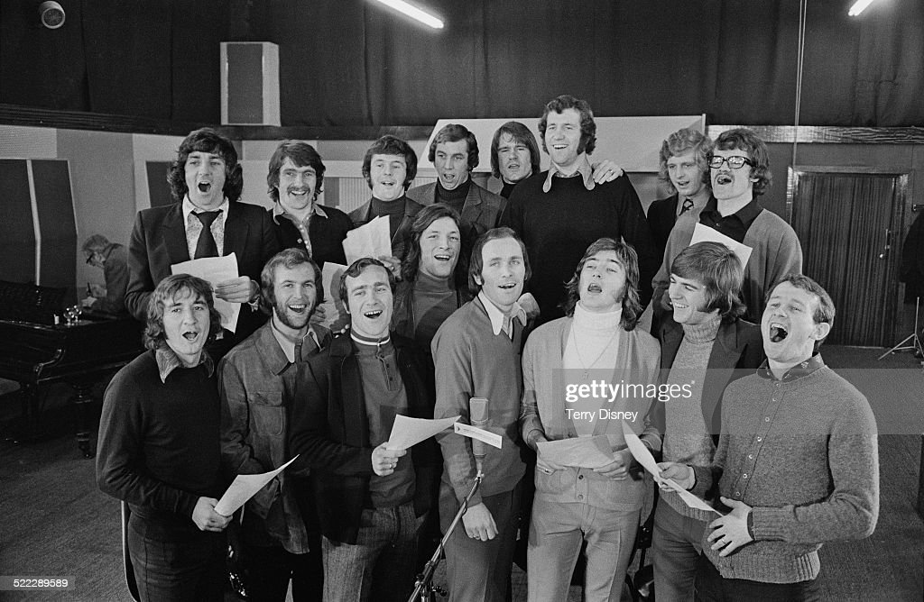 Members of the Chelsea football squad recording their song 'Blue Is The Colour', a month before their (ultimately unsuccessful) appearance in the Football League Cup Final against Stoke City, 3rd February 1972. Back row, left to right: Paddy Mulligan, Charlie Cooke, John Hollins, Marvin Hinton, David Webb, <a gi-track='captionPersonalityLinkClicked' href=/galleries/search?phrase=Peter+Osgood&family=editorial&specificpeople=242924 ng-click='$event.stopPropagation()'>Peter Osgood</a>, Chris Garland and Eddie McCreadie. Front row: Steve Kember, Tommy Baldwin, <a gi-track='captionPersonalityLinkClicked' href=/galleries/search?phrase=Ron+Harris+-+Soccer+Player&family=editorial&specificpeople=5605598 ng-click='$event.stopPropagation()'>Ron Harris</a>, Micky Droy, John Dempsey, Alan Hudson, John Phillips and Peter Houseman.
