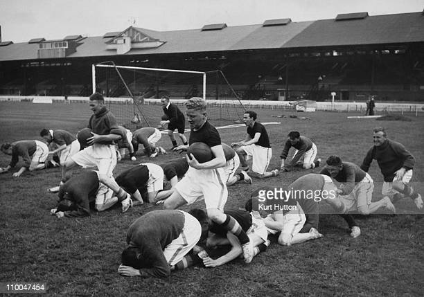 Members of the Chelsea squad training at Stamford Bridge London August 1939 Original publication Picture Post 216 Football Kicks Off Again pub 26th...