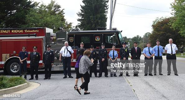 Members of the Chestnut RidgeVolunteer fire department line up outside the funeral services for Lenny Robinson better known as the Route 29 Batman...
